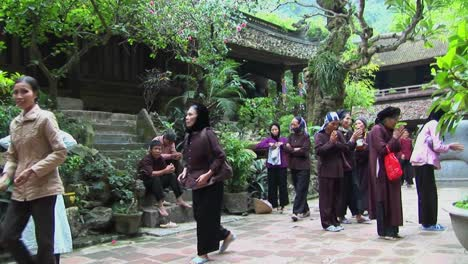 Vietnamese-women-practice-tai-chi-near-an-old-temple