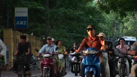 Motorbikes-move-along-a-road-in-ho-Chi-Minh-City-Vietnam