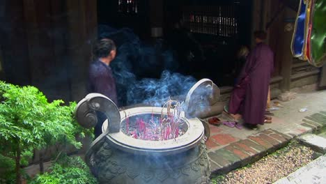 Monks-gather-as-incense-scents-the-air-at-a-Vietnamese-temple