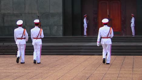 Vietnamese-guards-walk-in-front-of-the-tomb-of-Ho-Chi-Minh