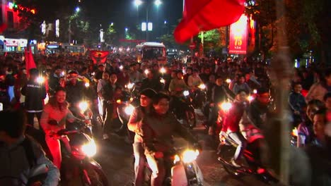 Motorcycles-flying-the-Vietnamese-flag-crowd-a-boulevard-during-a-political-demonstration