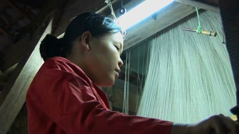 A-woman-operates-a-loom-in-a-factory-in-Vietnam