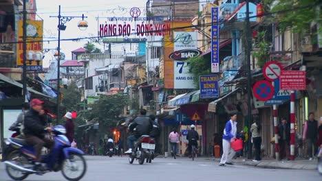 Pedestrians-walk-in-downtown-Hanoi