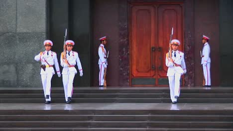 Soldiers-march-in-formation-outside-the-tomb-of-Ho-Chi-Minh-in-Hanoi-Vietnam