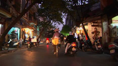 A-point-of-view-shot-from-a-motorbike-heading-through-traffic-in-Vietnam
