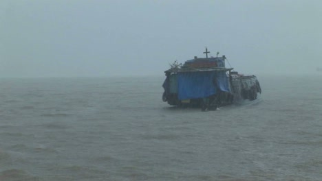 A-dilapidated-vessel-heads-out-into-a-heavy-storm