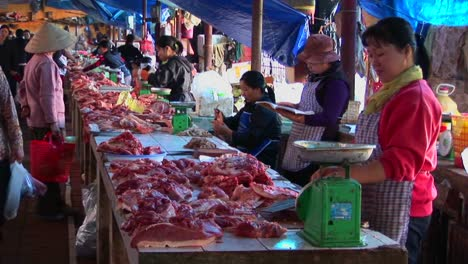 Food-sellers-offer-their-wares-in-a-Vietnamese-meat-market