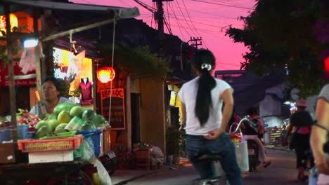 Vendors-wheel-their-wares-out-at-dusk-in-a-Vietnamese-village