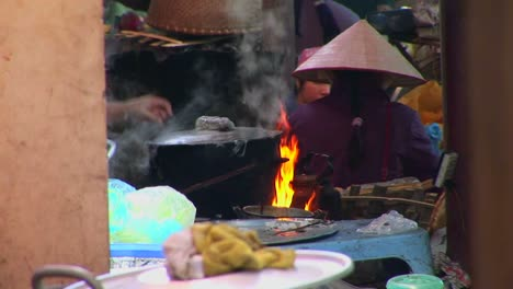 Fires-burn-and-a-pot-boils-as-Vietnamese-villagers-prepare-a-meal