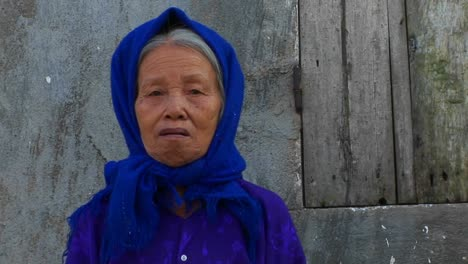 An-old-woman-in-Vietnam-peers-at-the-camera