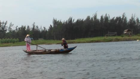 A-Vietnamese-fisherman-casts-his-net-into-a-river