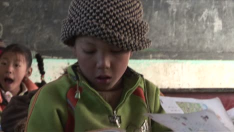 Children-practice-writing-in-a-rural-classroom-in-China-2