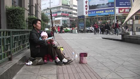 A-blind-man-plays-music-along-a-street-in-modern-China-1