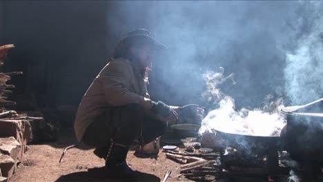 A-Chinese-cowboy-sits-by-a-fire-and-smokes