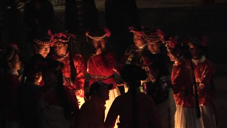 Ethnic-Chinese-gather-around-a-fire-at-night-for-a-ceremony