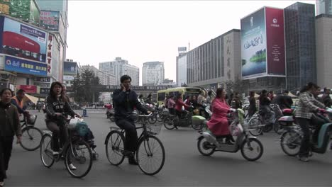 Crowds-of-people-and-bicycles-circulate-on-the-streets-of-Beijing-China