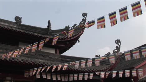 Flags-hang-from-the-eaves-of-a-Chinese-temple