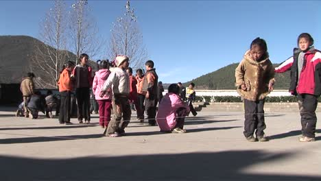Chinese-children-play-games-in-a-schoolyard