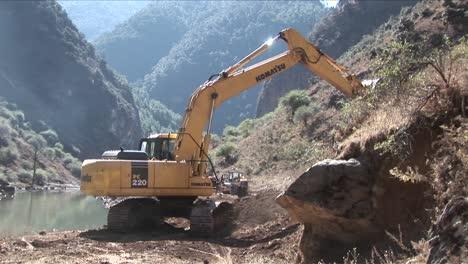 A-steam-shovel-moves-earth-along-a-rural-road