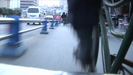A-POV-shot-of-a-man-pedaling-a-rickshaw-through-the-streets-of-Beijing-China