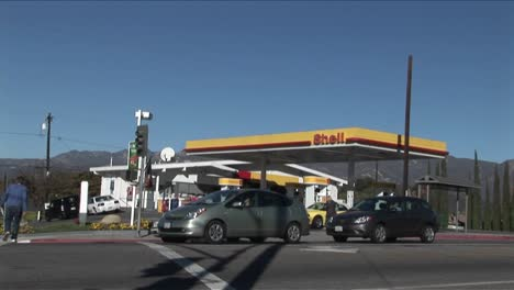 A-time-lapse-shot-of-a-gas-station-as-traffic-moves-quickly-by