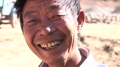 A-happy-Asian-man-smiles-at-the-camera