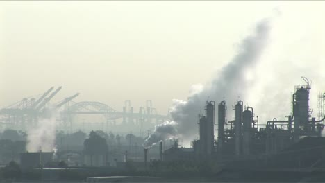 Smoke-rises-from-a-petrochemical-factory-or-oil-refinery-under-a-cloudy-sky-1
