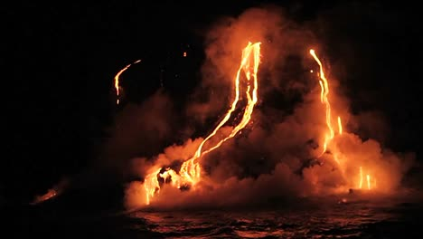 Spectacular-nighttime-lava-flow-from-a-volcano-into-ocean