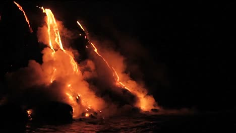 Spectacular-nighttime-lava-flow-from-a-volcano-into-ocean-1