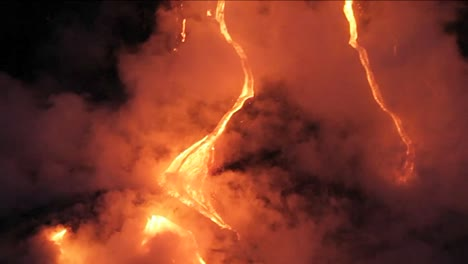 Spectacular-nighttime-lava-flow-from-a-volcano-into-ocean-4