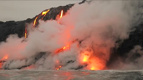 Spectacular-dusk-lava-flow-from-a-volcano-into-ocean