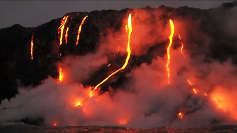 Spectacular-dusk-lava-flow-from-a-volcano-into-ocean-1