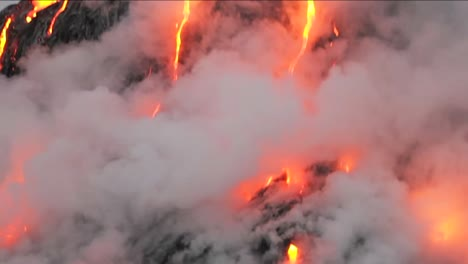 Spectacular-dusk-lava-flow-from-a-volcano-into-ocean-2