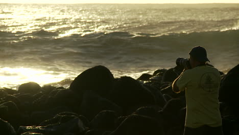A-photographer-follows-large-waves-as-they-crest-and-break-in-slow-motion
