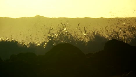 Large-waves-as-they-crest-and-break-in-slow-motion-at-sunset-3