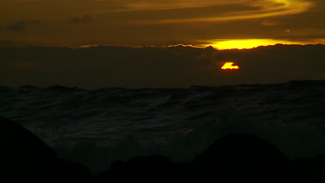 The-sunset-behind-waves-as-they-crest-and-break-in-slow-motion-at-sunset-6