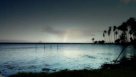 A-time-lapse-show-of-clouds-over-a-Hawaiian-scene-with-a-rainbow-forming