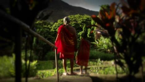 A-native-man-in-Hawaii-stands-in-a-field-and-a-child-suddenly-appears-next-to-him