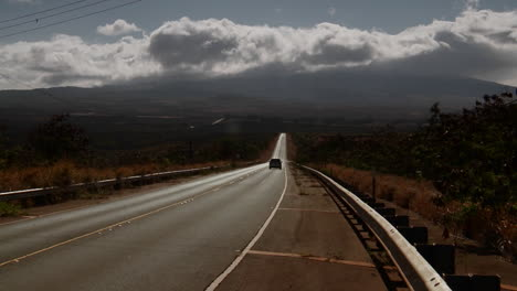 A-minivan-travels-along-a-lonely-road-into-the-wilderness