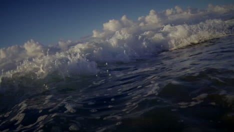 POV-shot-of-waves-crashing-into-shore-including-underwater-perspective-2