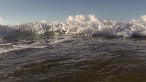 POV-shot-of-slow-motion-waves-crashing-into-shore-including-underwater-perspective-2
