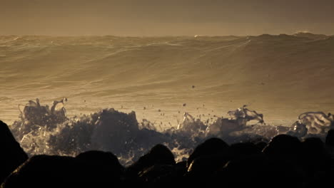 Waves-crash-against-a-rocky-shoreline