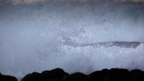 Huge-waves-roll-in-and-crash-against-a-rocky-shoreline