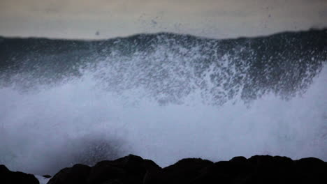 Huge-waves-roll-in-and-crash-against-a-rocky-shoreline-6