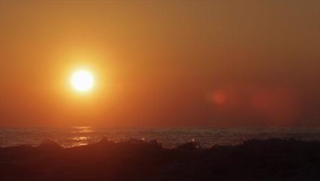 The-sun-sets-behind-beautiful-ocean-waves