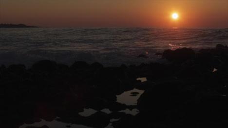 The-sun-sets-behind-beautiful-ocean-waves-2