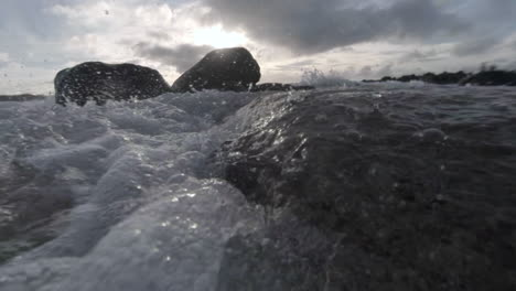 Water-level-view-of-waves-crashing-and-rolling-into-shore-in-slow-motion-1