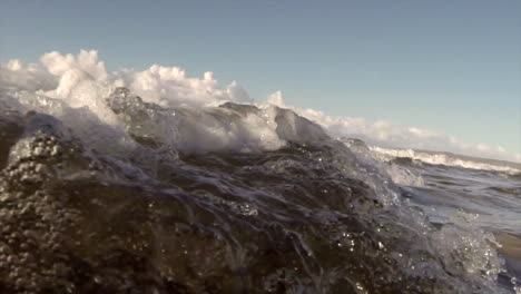 Water-level-view-of-waves-crashing-and-rolling-into-shore-in-slow-motion-6
