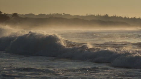 Waves-roll-into-a-beach-following-a-big-storm-in-slow-motion