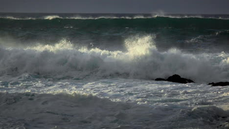 Waves-roll-into-a-beach-following-a-big-storm-in-slow-motion-3